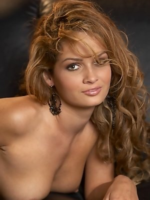 Prinzzess pulls off her black undies to feel the couch's cool black leather slide against her dark olive pussy and breasts.